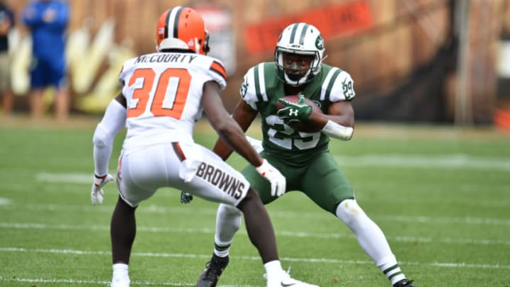 CLEVELAND, OH - OCTOBER 08: Bilal Powell #29 of the New York Jets attempts to move past Jason McCourty #30 of the Cleveland Browns at FirstEnergy Stadium on October 8, 2017 in Cleveland, Ohio. (Photo by Jason Miller/Getty Images)