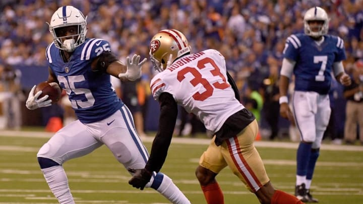 INDIANAPOLIS, IN - OCTOBER 08: Marlon Mack #25 of the Indianapolis Colts stiff arms Rashard Robinson #33 of the San Francisco 49ers as he runs towards the end zone during the game between the Indianapolis Colts and the San Francisco 49ers at Lucas Oil Stadium on October 8, 2017 in Indianapolis, Indiana. (Photo by Bobby Ellis/Getty Images)