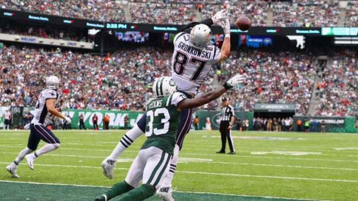 EAST RUTHERFORD, NJ - OCTOBER 15: Tight end Rob Gronkowski #87 of the New England Patriots scores a touchdown against strong safety Jamal Adams #33 of the New York Jets during the second quarter of their game at MetLife Stadium on October 15, 2017 in East Rutherford, New Jersey. (Photo by Al Bello/Getty Images)
