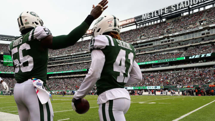 EAST RUTHERFORD, NJ - OCTOBER 15: Cornerback Buster Skrine #41 of the New York Jets celebrates his interception with teammate inside linebacker Demario Davis #56 against the New England Patriots during the second quarter of their game at MetLife Stadium on October 15, 2017 in East Rutherford, New Jersey. (Photo by Al Bello/Getty Images)