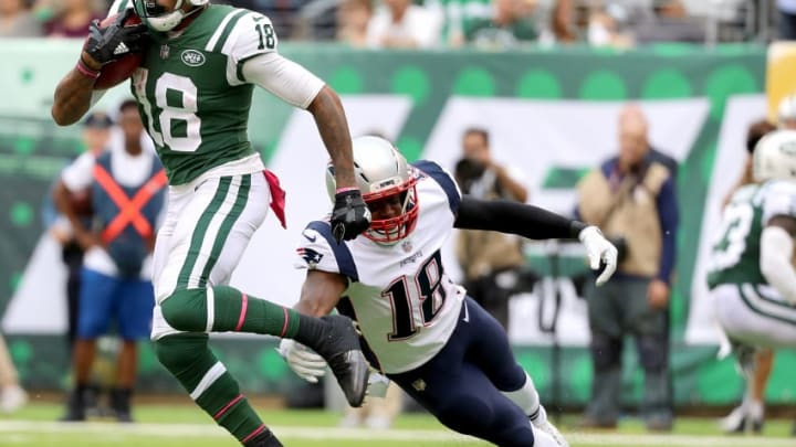 EAST RUTHERFORD, NJ - OCTOBER 15: ArDarius Stewart #18 of the New York Jets returns a kick against Matthew Slater #18 of the New England Patriots in the second half during their game at MetLife Stadium on October 15, 2017 in East Rutherford, New Jersey. (Photo by Abbie Parr/Getty Images)