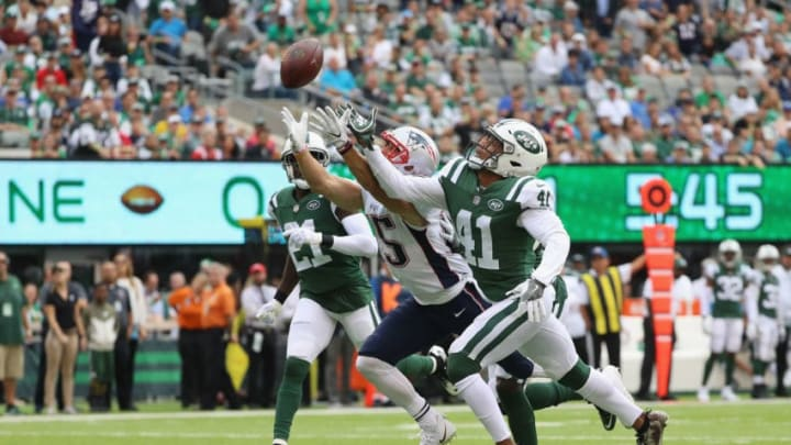 EAST RUTHERFORD, NJ - OCTOBER 15: Wide receiver Chris Hogan #15 of the New England Patriots tries for an incomplete pass against cornerback Buster Skrine #41 of the New York Jets during the second quarter of their game at MetLife Stadium on October 15, 2017 in East Rutherford, New Jersey. The New England Patriots won 24-17. (Photo by Abbie Parr/Getty Images)