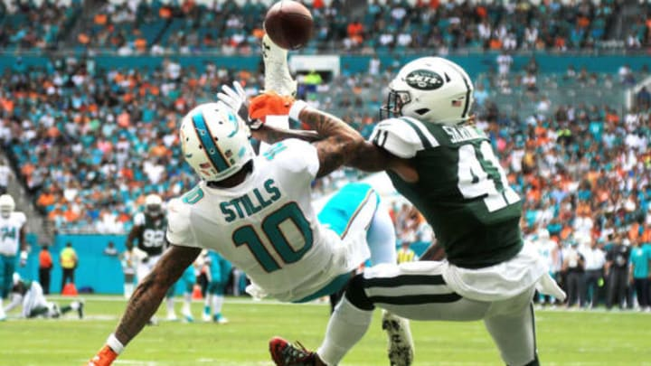 MIAMI GARDENS, FL – OCTOBER 22: Kenny Stills #10 of the Miami Dolphins attempts to make the catch over Buster Skrine #41 of the New York Jets during a game at Hard Rock Stadium on October 22, 2017 in Miami Gardens, Florida. (Photo by Mike Ehrmann/Getty Images)