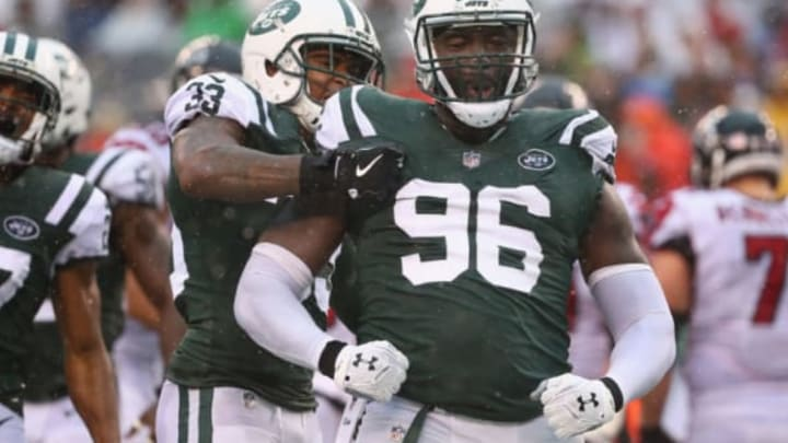 EAST RUTHERFORD, NJ – OCTOBER 29: Defensive end Muhammad Wilkerson #96 of the New York Jets celebrates a tackle against running back Tevin Coleman #26 (not pictured) of the Atlanta Falcons with teammate strong safety Jamal Adams #33 during the third quarter of the game at MetLife Stadium on October 29, 2017 in East Rutherford, New Jersey. (Photo by Al Bello/Getty Images)