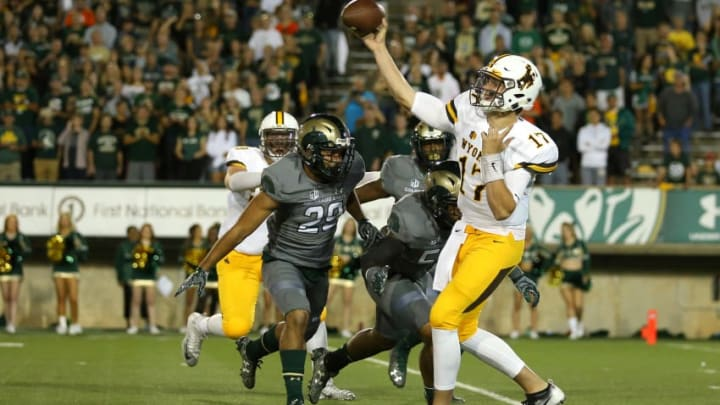 FORT COLLINS, CO - OCTOBER 1: Quarterback Josh Allen #17 of the Wyoming Cowboys throws a pass under pressure from the Colorado State Rams defense during the first quarter at Sonny Lubick Field at Hughes Stadium on October 1, 2016 in Fort Collins, Colorado. (Photo by Justin Edmonds/Getty Images)