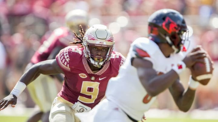 TALLAHASSEE, FL - OCTOBER 21: Defensive end Josh Sweat #9 of the Florida State Seminoles looks to sack quarterback Lamar Jackson #8 of the Louisville Cardinals at Doak Campbell Stadium on October 21, 2017 in Tallahassee, Florida. (Photo by Michael Chang/Getty Images)