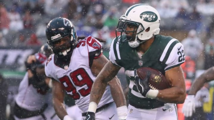 EAST RUTHERFORD, NJ - OCTOBER 29: Running back Matt Forte #22 of the New York Jets runs the ball against defensive end Adrian Clayborn #99 of the Atlanta Falcons during the fourth quarter of the game at MetLife Stadium on October 29, 2017 in East Rutherford, New Jersey. The Atlanta Falcons won 25-20. (Photo by Al Bello/Getty Images)