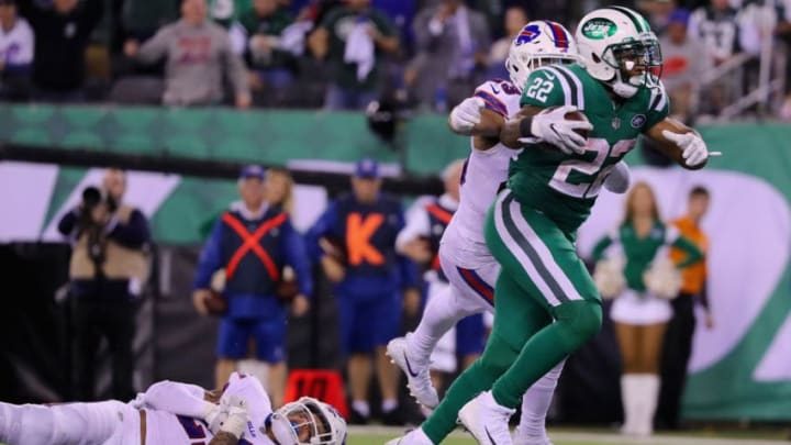 EAST RUTHERFORD, NJ - NOVEMBER 02: Running back Matt Forte #22 of the New York Jets avoids a tackle strong safety Micah Hyde #23 of the Buffalo Bills to score a touchdown during the fourth quarter of the game at MetLife Stadium on November 2, 2017 in East Rutherford, New Jersey. (Photo by Abbie Parr/Getty Images)