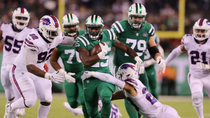 EAST RUTHERFORD, NJ - NOVEMBER 02: Elijah McGuire #25 of the New York Jets carries the ball as Micah Hyde #23 of the Buffalo Bills defend in the fourth quarter during the fourth quarter of the game at MetLife Stadium on November 2, 2017 in East Rutherford, New Jersey. (Photo by Elsa/Getty Images)