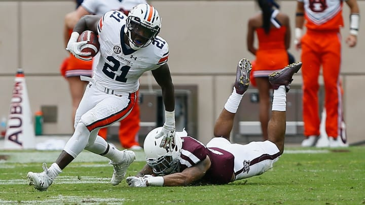 COLLEGE STATION, TX – NOVEMBER 04: Kerryon Johnson #21 of the Auburn Tigers fends off Larry Pryor #11 of the Texas A&M Aggies at Kyle Field on November 4, 2017 in College Station, Texas. (Photo by Bob Levey/Getty Images)