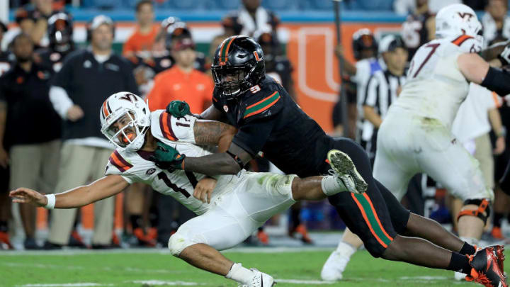 MIAMI GARDENS, FL - NOVEMBER 04: Josh Jackson #17 of the Virginia Tech Hokies is tackled by Chad Thomas #9 of the Miami Hurricanes during a game at Hard Rock Stadium on November 4, 2017 in Miami Gardens, Florida. (Photo by Mike Ehrmann/Getty Images)