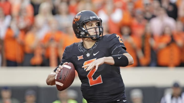 STILLWATER, OK - NOVEMBER 04: Quarterback Mason Rudolph #2 of the Oklahoma State Cowboys looks to throw against the Oklahoma Sooners at Boone Pickens Stadium on November 4, 2017 in Stillwater, Oklahoma. Oklahoma defeated Oklahoma State 62-52. (Photo by Brett Deering/Getty Images)