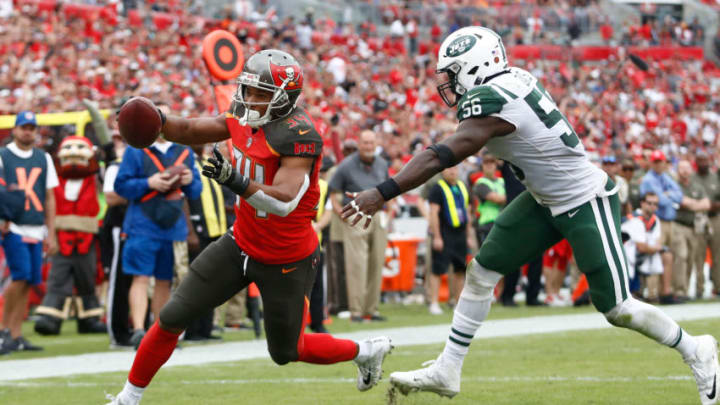 TAMPA, FL - NOVEMBER 12: Running back Charles Sims #34 of the Tampa Bay Buccaneers evades inside linebacker Demario Davis #56 of the New York Jets as he runs into the end zone for a touchdown during the fourth quarter of an NFL football game on November 12, 2017 at Raymond James Stadium in Tampa, Florida. (Photo by Brian Blanco/Getty Images)