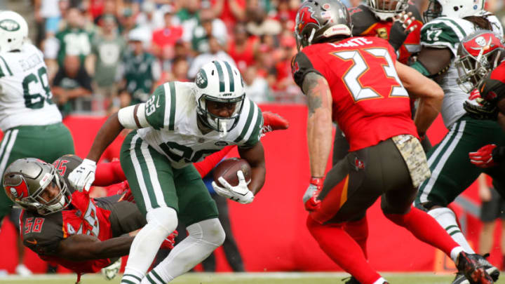 TAMPA, FL - NOVEMBER 12: Running back Bilal Powell #29 of the New York Jets finds room to run between middle linebacker Kwon Alexander #58 of the Tampa Bay Buccaneers and free safety Chris Conte #23 during the third quarter of an NFL football game on November 12, 2017 at Raymond James Stadium in Tampa, Florida. (Photo by Brian Blanco/Getty Images)