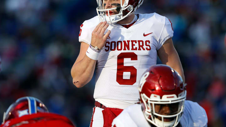 LAWRENCE, KS – NOVEMBER 18: Quarterback Baker Mayfield #6 of the Oklahoma Sooners prepares to take a snap during the game against the Kansas Jayhawks at Memorial Stadium on November 18, 2017 in Lawrence, Kansas. (Photo by Jamie Squire/Getty Images)