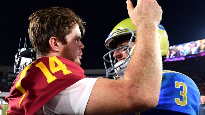 LOS ANGELES, CA – NOVEMBER 18: Josh Rosen #3 of the UCLA Bruins and Sam Darnold #14 of the USC Trojans meet on the field after a 28-23 Trojan win at Los Angeles Memorial Coliseum on November 18, 2017 in Los Angeles, California. (Photo by Harry How/Getty Images)