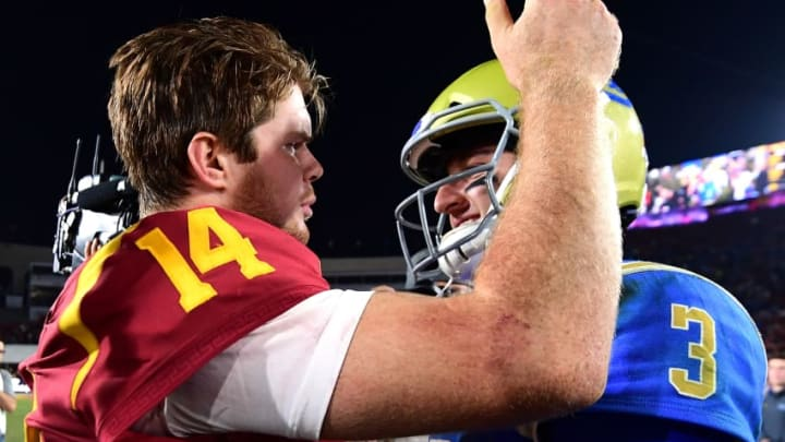 LOS ANGELES, CA - NOVEMBER 18: Josh Rosen #3 of the UCLA Bruins and Sam Darnold #14 of the USC Trojans meet on the field after a 28-23 Trojan win at Los Angeles Memorial Coliseum on November 18, 2017 in Los Angeles, California. (Photo by Harry How/Getty Images)