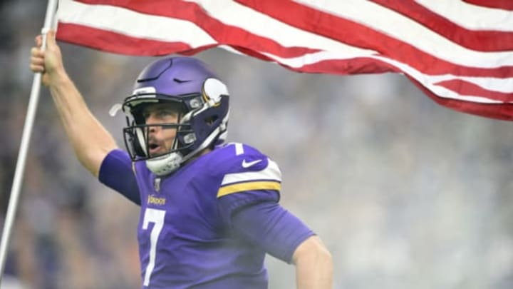 MINNEAPOLIS, MN – NOVEMBER 19: Case Keenum #7 of the Minnesota Vikings carries out an American flag during player introductions before the game against the Los Angeles Rams on November 19, 2017 at U.S. Bank Stadium in Minneapolis, Minnesota. (Photo by Hannah Foslien/Getty Images)