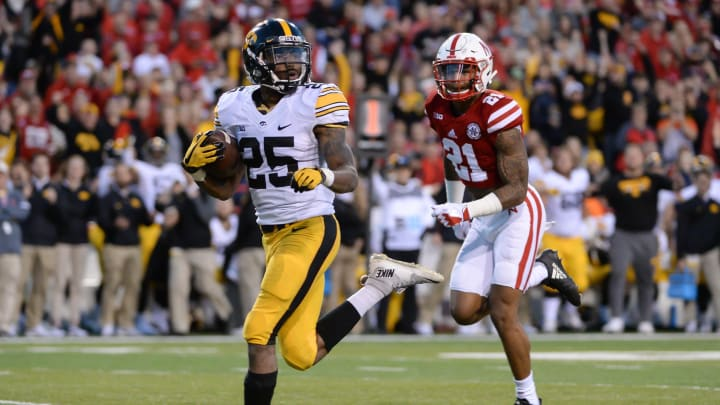 LINCOLN, NE – NOVEMBER 24: Running back Akrum Wadley #25 of the Iowa Hawkeyes scores against defensive back Lamar Jackson #21 of the Nebraska Cornhuskers at Memorial Stadium on November 24, 2017 in Lincoln, Nebraska. (Photo by Steven Branscombe/Getty Images)