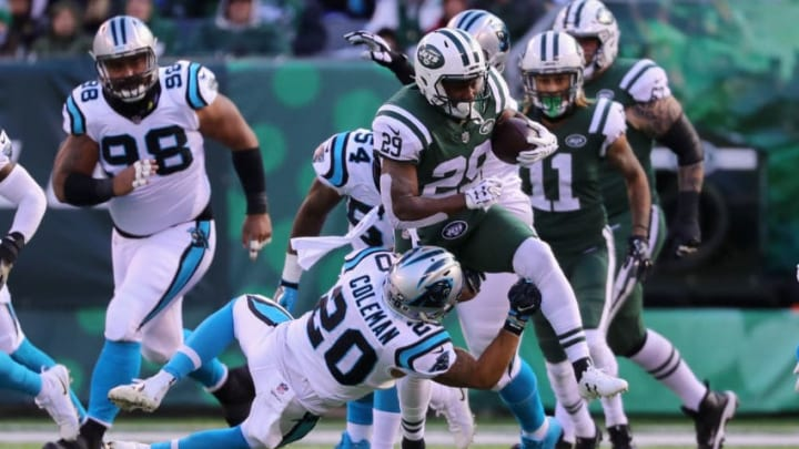 EAST RUTHERFORD, NJ - NOVEMBER 26: Running back Bilal Powell #29 of the New York Jets is tackled by free safety Kurt Coleman #20 of the Carolina Panthers during the first quarter of the game at MetLife Stadium on November 26, 2017 in East Rutherford, New Jersey. (Photo by Abbie Parr/Getty Images)