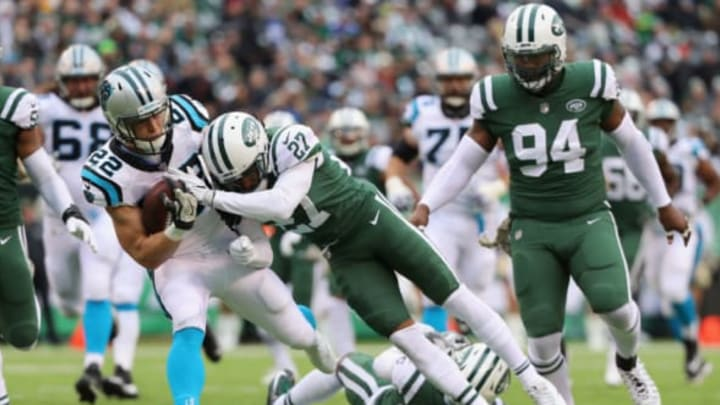 EAST RUTHERFORD, NJ – NOVEMBER 26: Running back Christian McCaffrey #22 of the Carolina Panthers is tackled by cornerback Darryl Roberts #27 of the New York Jets during the first half of the game at MetLife Stadium on November 26, 2017 in East Rutherford, New Jersey. (Photo by Abbie Parr/Getty Images)
