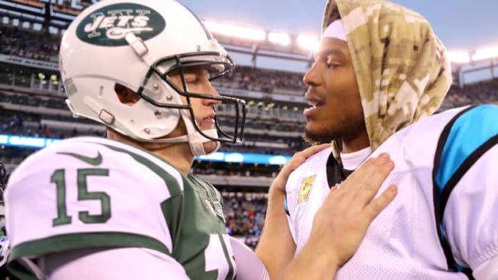 EAST RUTHERFORD, NJ - NOVEMBER 26: Josh McCown #15 of the New York Jets and Cam Newton #1 of the Carolina Panthers shake hands following the Panthers' 35-27 win at MetLife Stadium on November 26, 2017 in East Rutherford, New Jersey. (Photo by Abbie Parr/Getty Images)
