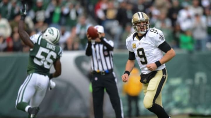 EAST RUTHERFORD, NJ – NOVEMBER 3: Quarterback Drew Brees #9 of the New Orleans Saints jogs off the field after an interception by inside linebacker DeMario Davis #56 of the New York Jets in the 1st quarter at MetLife Stadium on November 3, 2013 in East Rutherford, New Jersey. (Photo by Ron Antonelli/Getty Images)