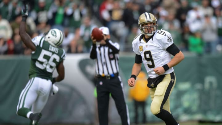 EAST RUTHERFORD, NJ - NOVEMBER 3: Quarterback Drew Brees #9 of the New Orleans Saints jogs off the field after an interception by inside linebacker DeMario Davis #56 of the New York Jets in the 1st quarter at MetLife Stadium on November 3, 2013 in East Rutherford, New Jersey. (Photo by Ron Antonelli/Getty Images)