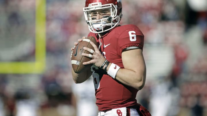 NORMAN, OK – NOVEMBER 25: Quarterback Baker Mayfield #6 of the Oklahoma Sooners warms up before the game against the West Virginia Mountaineers at Gaylord Family Oklahoma Memorial Stadium on November 25, 2017 in Norman, Oklahoma. Oklahoma defeated West Virginia 59-31. (Photo by Brett Deering/Getty Images)