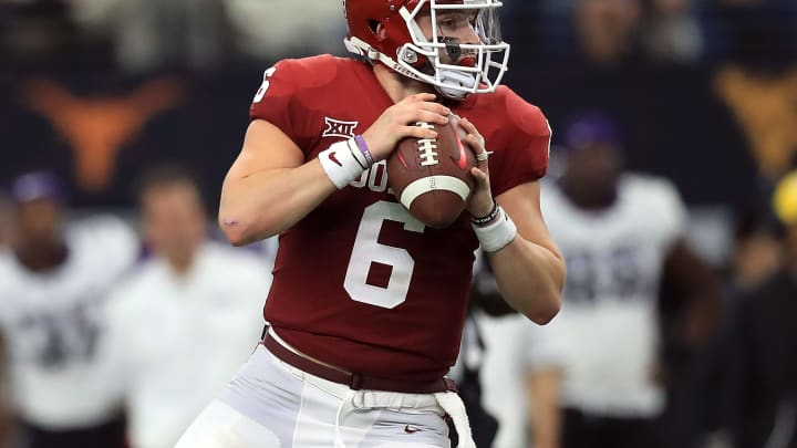 ARLINGTON, TX – DECEMBER 02: Baker Mayfield #6 of the Oklahoma Sooners looks to pass against the TCU Horned Frogs in the second quarter during Big 12 Championship at AT&T Stadium on December 2, 2017 in Arlington, Texas. (Photo by Ronald Martinez/Getty Images)