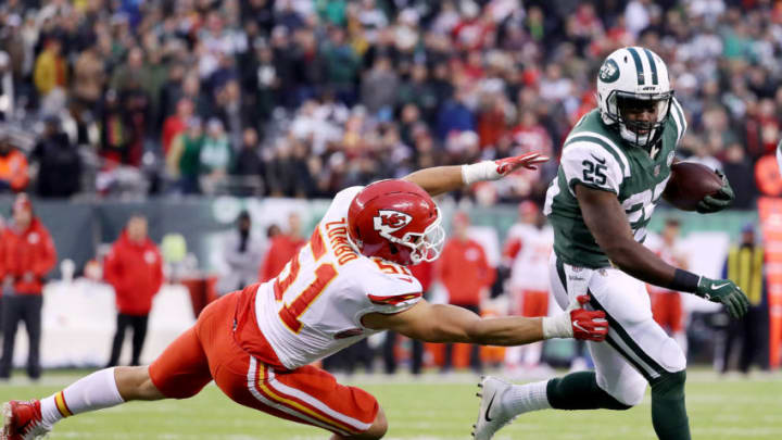 EAST RUTHERFORD, NEW JERSEY - DECEMBER 03: Elijah McGuire #25 of the New York Jets carries the ball as Frank Zombo #51 of the Kansas City Chiefs defends in the fourth quarter on December 03, 2017 at MetLife Stadium in East Rutherford, New Jersey.The New York Jets defeated the Kansas City Chiefs 38-31. (Photo by Elsa/Getty Images)