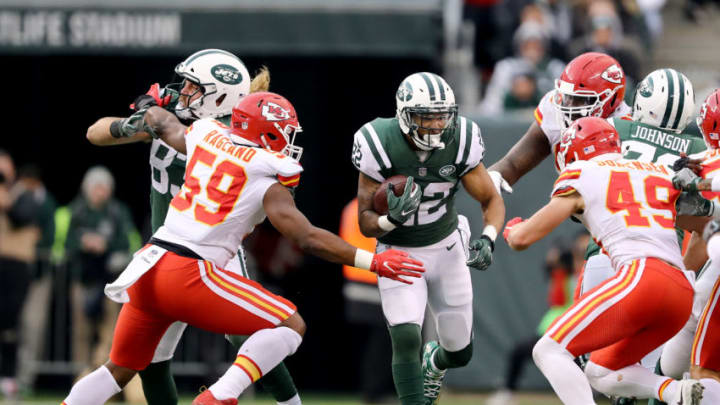 EAST RUTHERFORD, NEW JERSEY - DECEMBER 03: Matt Forte #22 of the New York Jets carries the ball as Reggie Ragland #59 and Daniel Sorensen #49 of the Kansas City Chiefs defend on December 03, 2017 at MetLife Stadium in East Rutherford, New Jersey.The New York Jets defeated the Kansas City Chiefs 38-31. (Photo by Elsa/Getty Images)