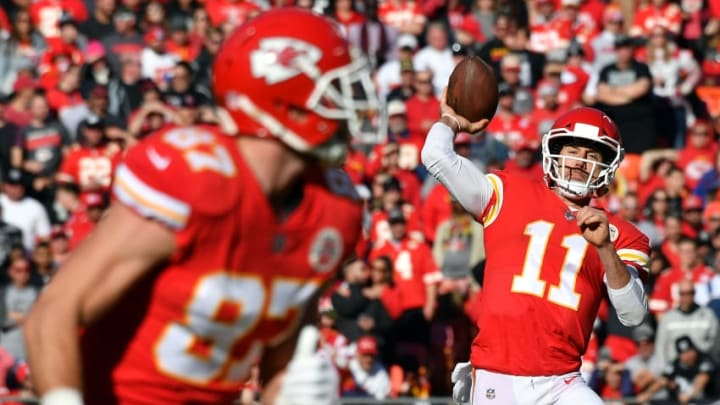 KANSAS CITY, MO - DECEMBER 10: Quarterback Alex Smith #11 of the Kansas City Chiefs passes to tight end Travis Kelce #87 during the game against the Oakland Raiders at Arrowhead Stadium on December 10, 2017 in Kansas City, Missouri. (Photo by Peter Aiken/Getty Images)