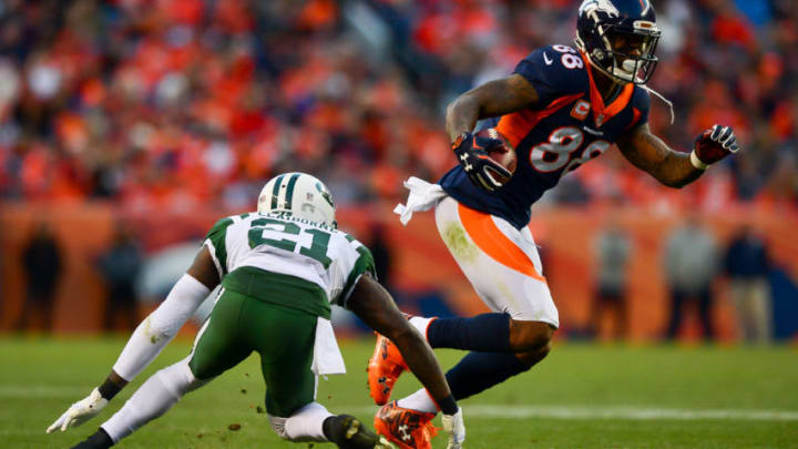 DENVER, CO - DECEMBER 10: Wide receiver Demaryius Thomas #88 of the Denver Broncos makes a catch under coverage by cornerback Morris Claiborne #21 of the New York Jets in the fourth quarter of a game at Sports Authority Field at Mile High on December 10, 2017 in Denver, Colorado. (Photo by Dustin Bradford/Getty Images)