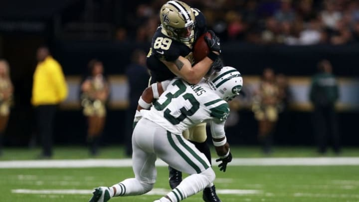 NEW ORLEANS, LA - DECEMBER 17: Tight end Josh Hill #89 of the New Orleans Saints is tackled by strong safety Jamal Adams #33 of the New York Jets during the second half of a game at the Mercedes-Benz Superdome on December 17, 2017 in New Orleans, Louisiana. (Photo by Sean Gardner/Getty Images)R 17: Tight end Josh Hill