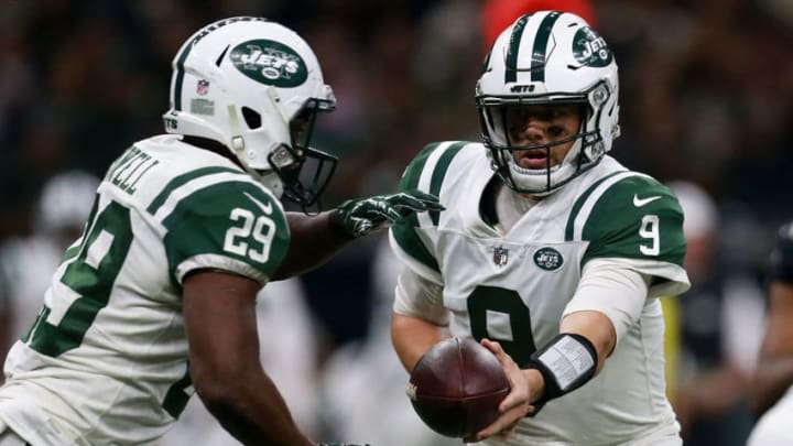 NEW ORLEANS, LA - DECEMBER 17: Quarterback Bryce Petty #9 of the New York Jets hands the ball to running back Bilal Powell #29 during the second half of a game against the New Orleans Saints at the Mercedes-Benz Superdome on December 17, 2017 in New Orleans, Louisiana. (Photo by Sean Gardner/Getty Images)