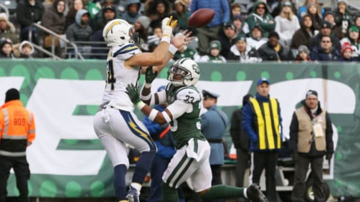 EAST RUTHERFORD, NJ – DECEMBER 24: A pass intended for Sean McGrath #84 of the Los Angeles Chargers is defended by Jamal Adams #33 of the New York Jets during the second half of an NFL game at MetLife Stadium on December 24, 2017 in East Rutherford, New Jersey. (Photo by Ed Mulholland/Getty Images)