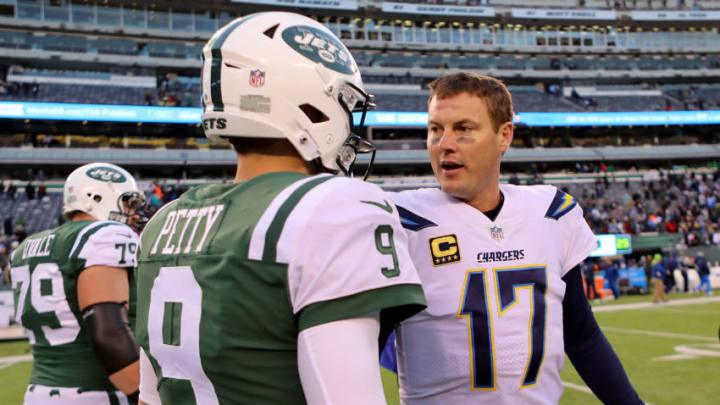 EAST RUTHERFORD, NJ - DECEMBER 24: Bryce Petty #9 of the New York Jets and Philip Rivers #17 of the Los Angeles Chargers converse following Chargers' 14-7 win at MetLife Stadium on December 24, 2017 in East Rutherford, New Jersey. (Photo by Abbie Parr/Getty Images)