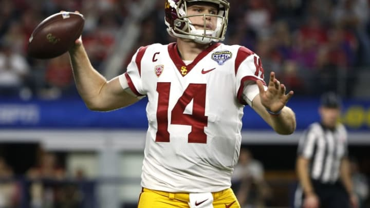 ARLINGTON, TX - DECEMBER 29: Sam Darnold #14 of the USC Trojans looks to throw against the Ohio State Buckeyes in the first half of the 82nd Goodyear Cotton Bowl Classic between USC and Ohio State at AT&T Stadium on December 29, 2017 in Arlington, Texas. (Photo by Ron Jenkins/Getty Images)
