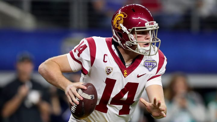 ARLINGTON, TX – DECEMBER 29: Sam Darnold #14 of the USC Trojans looks for an open receiver against the Ohio State Buckeyes during the Goodyear Cotton Bowl Classic at AT&T Stadium on December 29, 2017 in Arlington, Texas. (Photo by Tom Pennington/Getty Images)