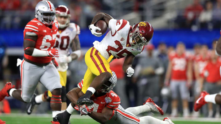 ARLINGTON, TX - DECEMBER 29: Ronald Jones II #25 of the USC Trojans runs the ball against Jordan Fuller #4 of the Ohio State Buckeyes in the third quarter during the Goodyear Cotton Bowl at AT&T Stadium on December 29, 2017 in Arlington, Texas. (Photo by Ronald Martinez/Getty Images)