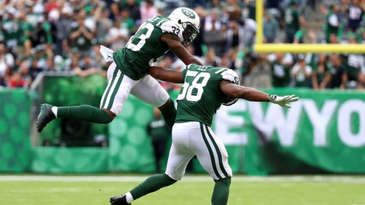 EAST RUTHERFORD, NJ - OCTOBER 15: Jamal Adams #33 and Darron Lee #58 of the New York Jets celebrate holding the New England Patriots on third down in the first quarter during their game at MetLife Stadium on October 15, 2017 in East Rutherford, New Jersey. (Photo by Abbie Parr/Getty Images)
