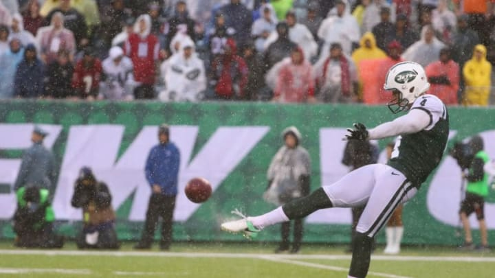 EAST RUTHERFORD, NJ - OCTOBER 29: Punter Lac Edwards #4 of the New York Jets punts the ball against the Atlanta Falcons during the fourth quarter of the game at MetLife Stadium on October 29, 2017 in East Rutherford, New Jersey. The Atlanta Falcons won 25-20. (Photo by Al Bello/Getty Images)