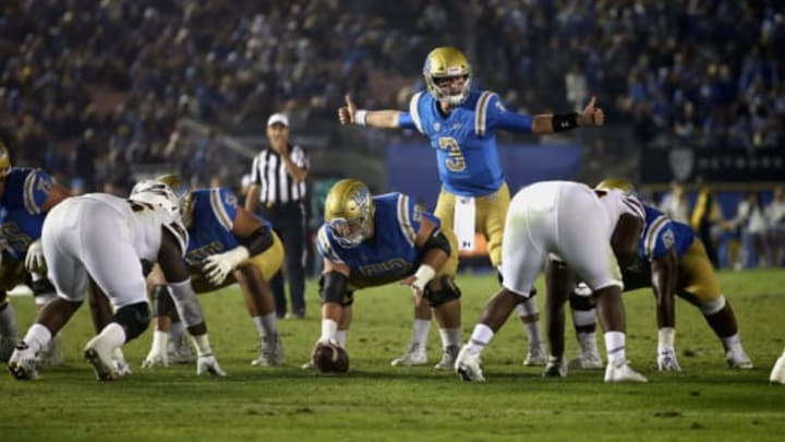 PASADENA, CA – NOVEMBER 11: Josh Rosen #3 and Jax Wacaser #53 of the UCLA Bruins line up at the line of scrimmage during the second half of a game against the Arizona State Sun Devils at the Rose Bowl on November 11, 2017 in Pasadena, California. (Photo by Sean M. Haffey/Getty Images)