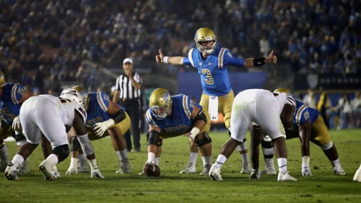 PASADENA, CA - NOVEMBER 11: Josh Rosen #3 and Jax Wacaser #53 of the UCLA Bruins line up at the line of scrimmage during the second half of a game against the Arizona State Sun Devils at the Rose Bowl on November 11, 2017 in Pasadena, California. (Photo by Sean M. Haffey/Getty Images)