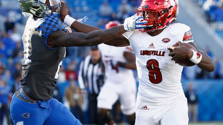 LEXINGTON, KY – NOVEMBER 25: Lamar Jackson #8 of the Louisville Cardinals runs with the ball while defended by Chris Westry #21 of the Kentucky Wildcats during the game at Commonwealth Stadium on November 25, 2017 in Lexington, Kentucky. (Photo by Andy Lyons/Getty Images)