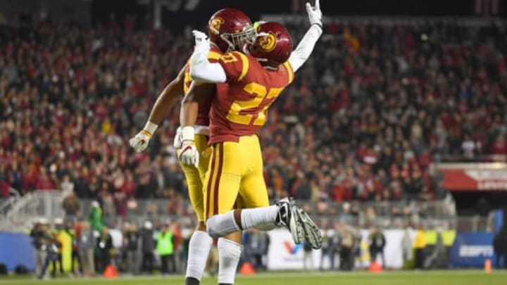 SANTA CLARA, CA – DECEMBER 01: Uchenna Nwosu #42 and Ajene Harris #27 of the USC Trojans celebrate after Nwosu stopped Cameron Scarlett #22 of the Stanford Cardinal a yard short of the goal line on fourth down during the Pac-12 Football Championship Game at Levi's Stadium on December 1, 2017 in Santa Clara, California. (Photo by Thearon W. Henderson/Getty Images)