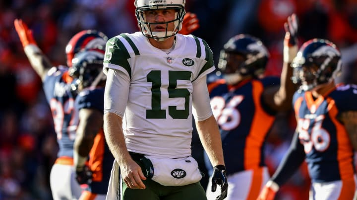 DENVER, CO – DECEMBER 10: Quarterback Josh McCown #15 of the New York Jets walks on the field as Denver Broncos defensive players celebrate after a sack in the first quarter of a game at Sports Authority Field at Mile High on December 10, 2017 in Denver, Colorado. (Photo by Dustin Bradford/Getty Images)