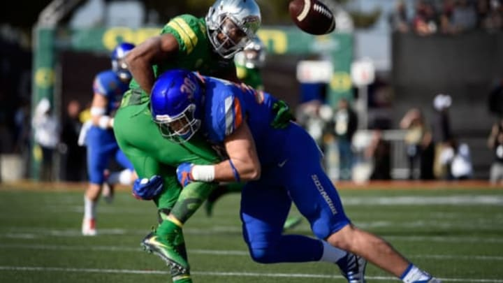 LAS VEGAS, NV – DECEMBER 16: Tony Brooks-James #20 of the Oregon Ducks fumbles the ball under pressure from Leighton Vander Esch #38 of the Boise State Broncos during the first half of the Las Vegas Bowl at Sam Boyd Stadium on December 16, 2017 in Las Vegas, Nevada. Boise State won 38-28. (Photo by David Becker/Getty Images)