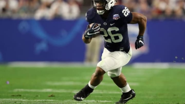 GLENDALE, AZ – DECEMBER 30: Running back Saquon Barkley #26 of the Penn State Nittany Lions rushes the football against the Washington Huskies during the second half of the Playstation Fiesta Bowl at University of Phoenix Stadium on December 30, 2017 in Glendale, Arizona. The Nittany Lions defeated the Huskies 35-28. (Photo by Christian Petersen/Getty Images)